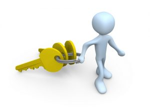 Royalty-free 3d computer generated people clipart graphic of a white figure pulling a large keyring with three golden keys on it, symbolizing a new homeowner or security.